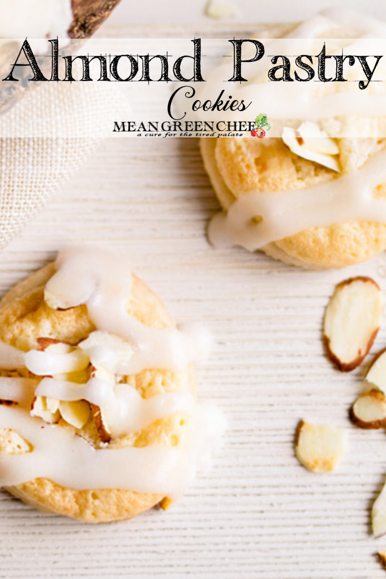 Almond Pastry Cookies on a white wooden background.