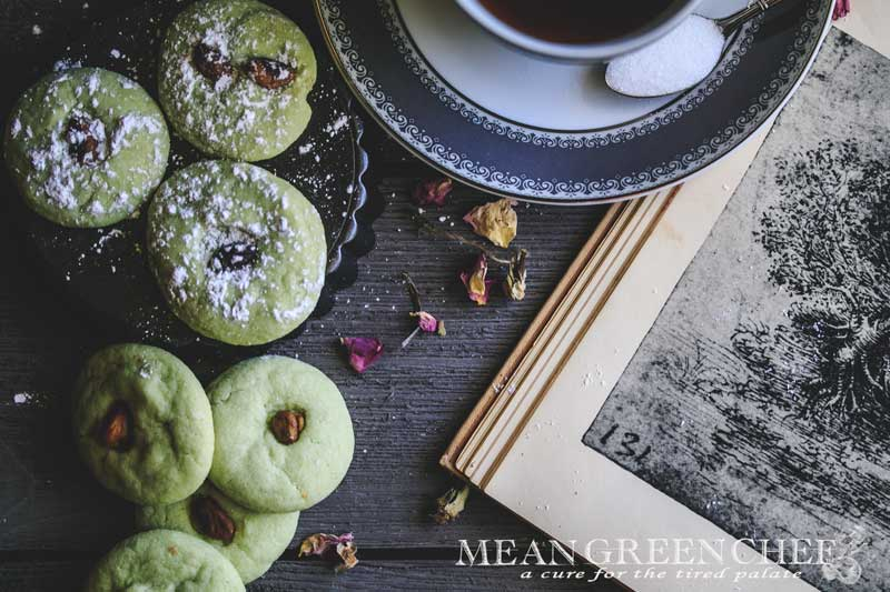 Overhead photo of green Pistachio Pudding Cookies on gray wooden background.