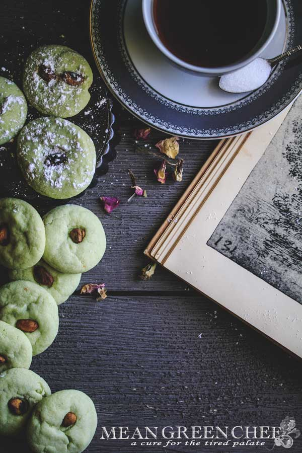 Photo of green Pistachio Pudding Cookies on gray wooden background.