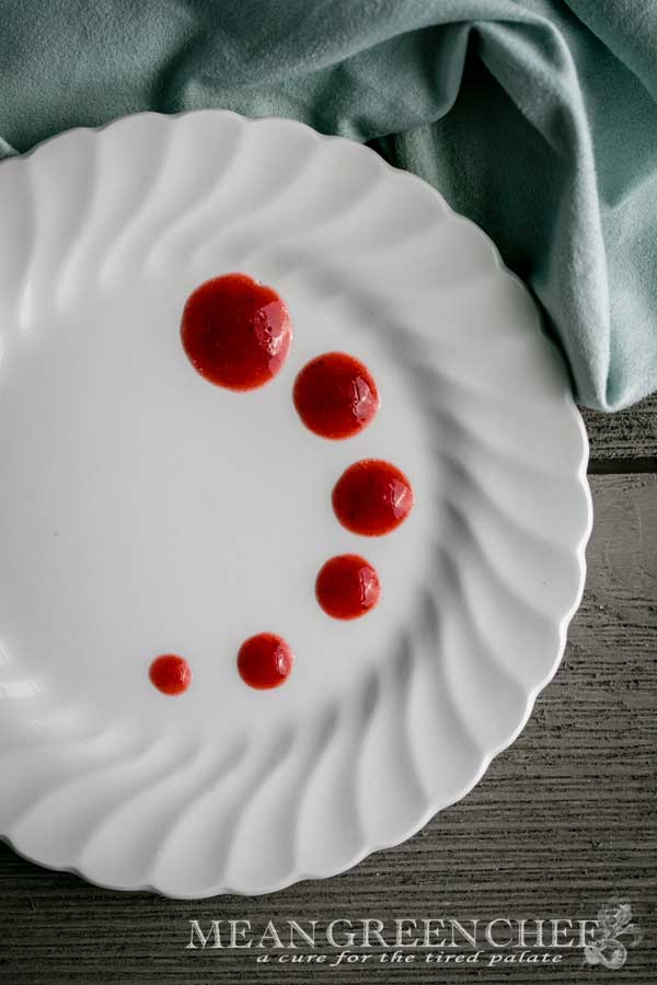 Fruit Coulis Recipe on a white plate ready for dessert to be added.