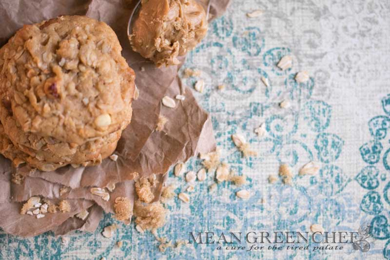 Stacked Peanut Butter Oatmeal Cookies pictured with brown sugar.