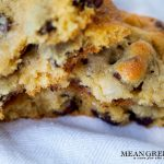 Bakery Style Chocolate Chip Cookies on a white kitchen towel