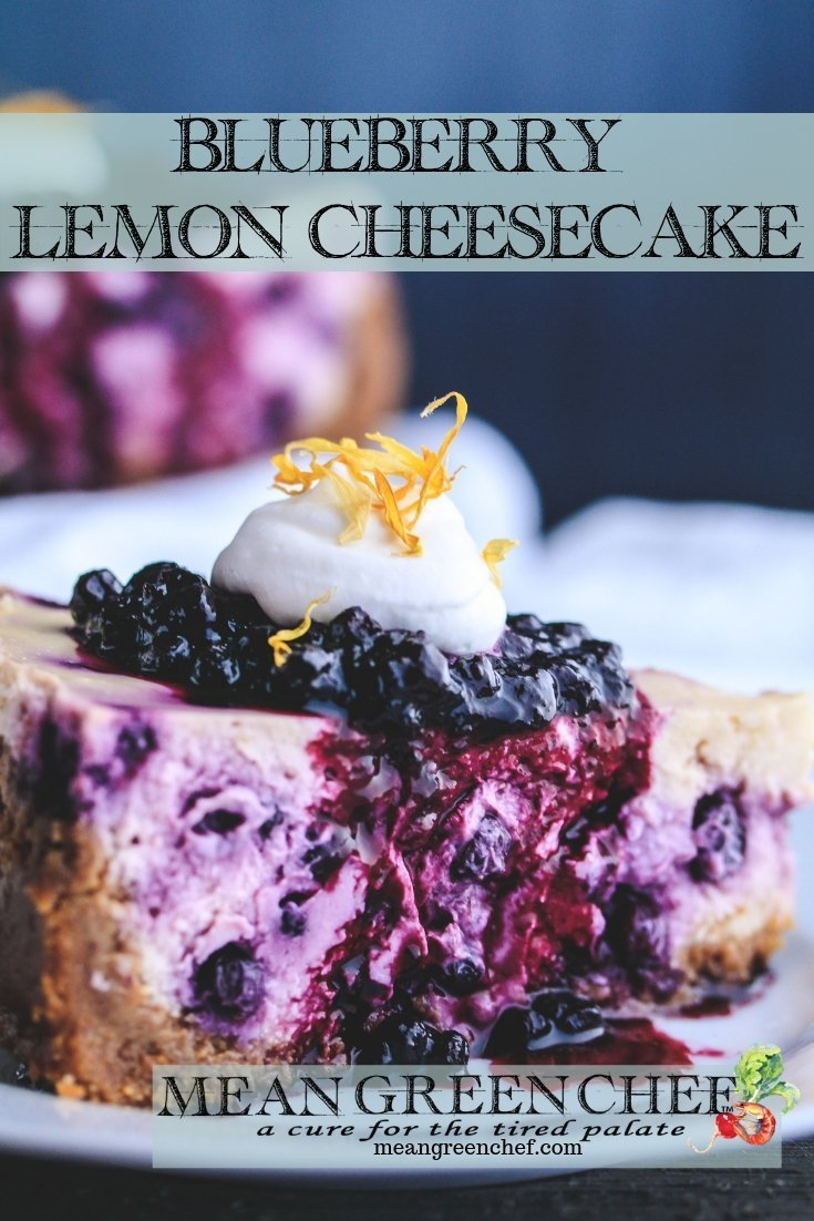 Side photo of a slice of Blueberry Lemon Cheesecake topped with blueberries and fresh whipped cream.