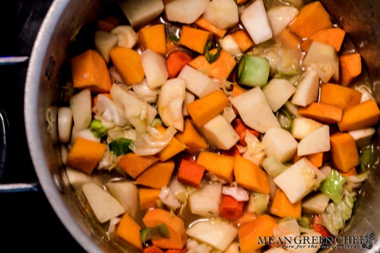 Ingredients cooking in a large stock pot on the stove top for Dutch Stamppot. Mean Green Chef