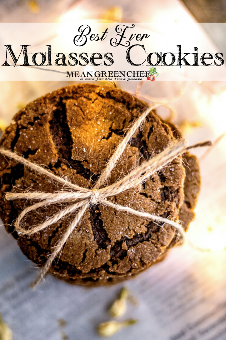 Stack of Molasses Cookies, tied with twine and sitting on newspaper that has been scattered with white flower buds.