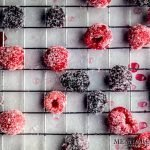 Sugared Blackberries and raspberries drying on a baking rack.