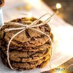 Stack of Molasses Cookies, tied with twine and sitting on a newspaper.