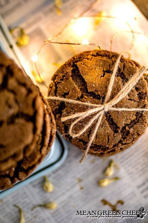 Overhead photo of a stack of Molasses Cookies, tied with twine and sitting on newspaper