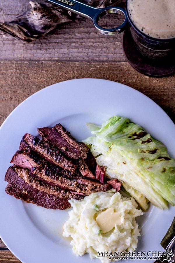 Plate of Traditional Irish Colcannon, Guinness Braised Corned Beef + Cabbage with stout.