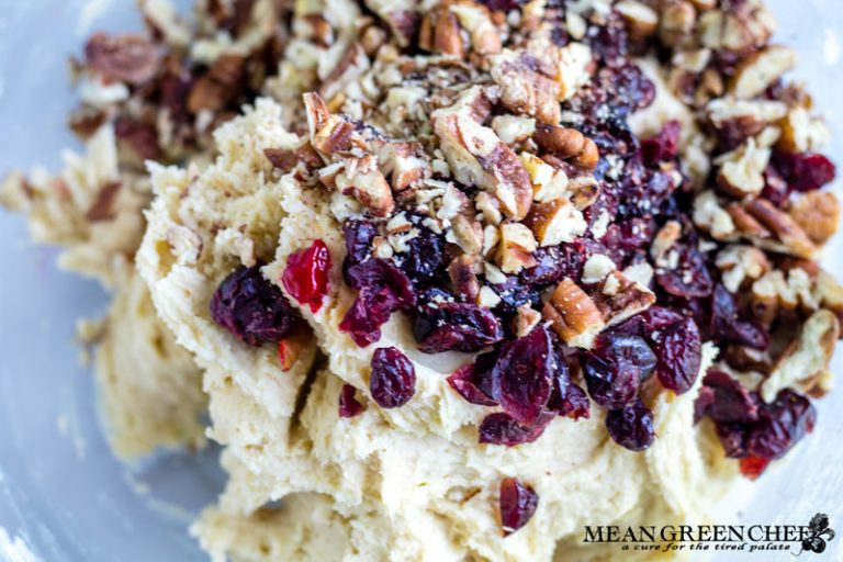 raw cookie dough with pecans, dried cranberries and a dot of pink food coloring for layered Orange Cranberry Icebox Cookies.