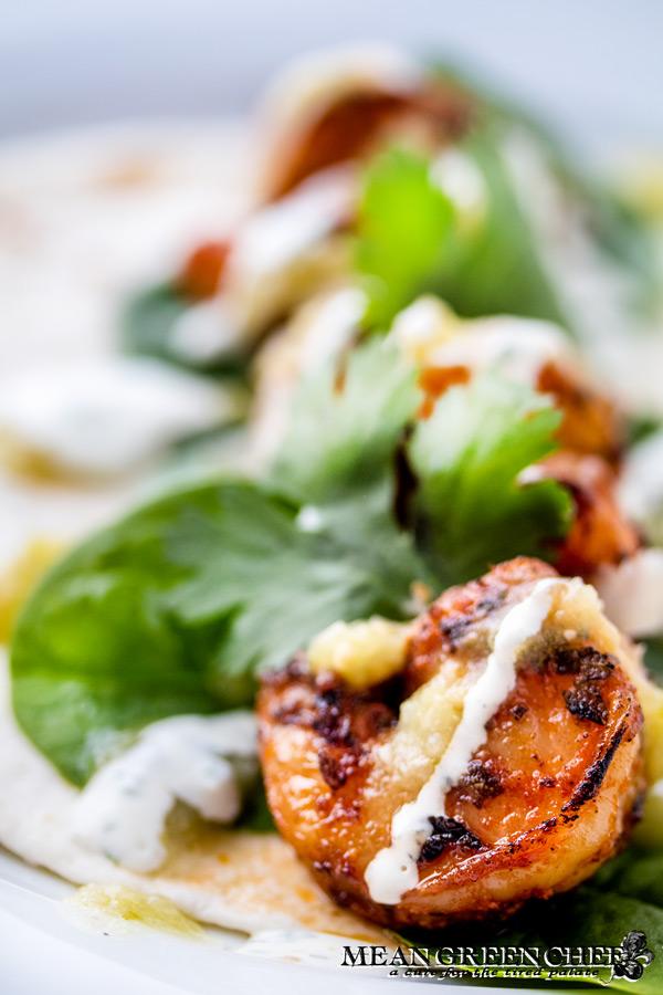 Close up of blackened shrimp with fresh cilantro.