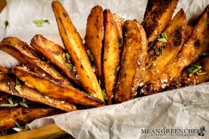 Crispy Oven Baked Fries sprinkled with fresh chopped Rosemary and Kosher sea salt.