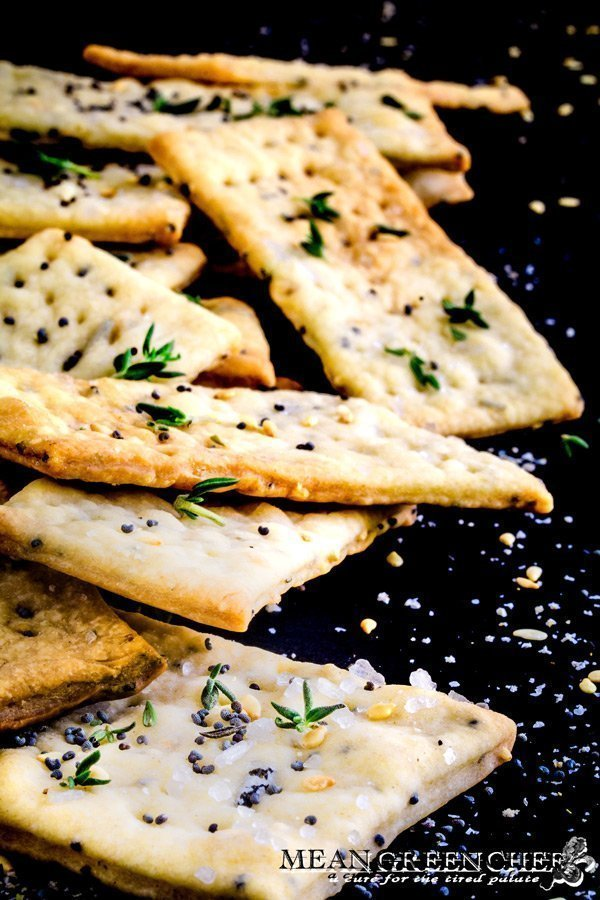Close up of Herbed Crackers on a black background.