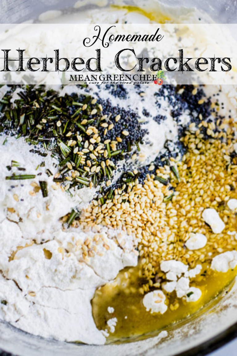 Ingredients for making herbed crackers in a glass bowl.