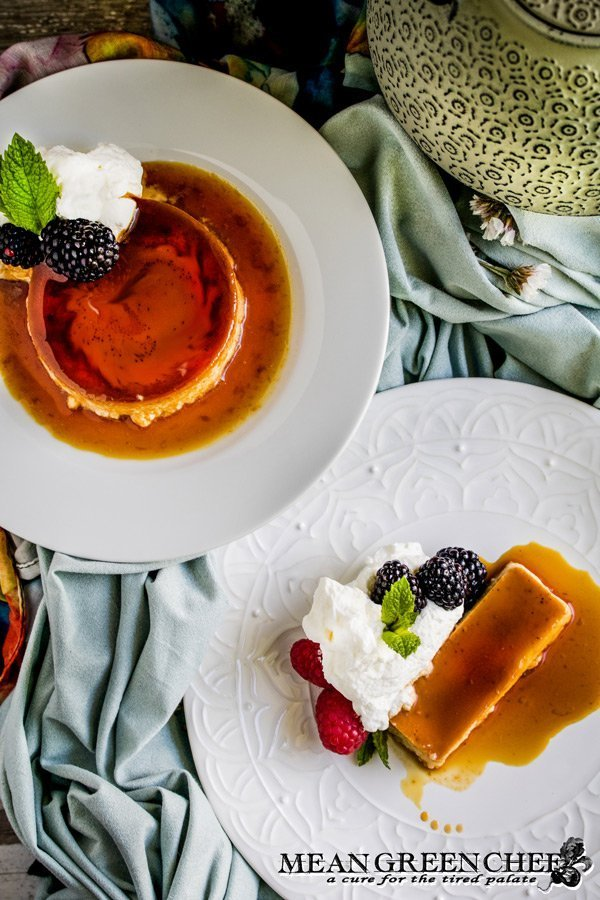 Overhead shot of Classic Flan with berries and mint.