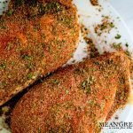 Blackened Chicken breasts with Badass Blackened Seasoning resting on a white plate.