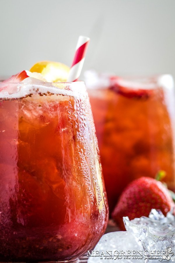 Instant Pot Strawberry Iced Tea served over ice and garnished with fresh fruit