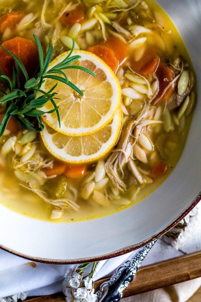 White bowl of Lemon Chicken Orzo Soup