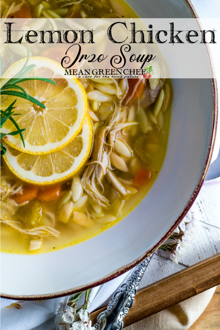 White bowl with a gold rim filled with Lemon Chicken Orzo Soup.