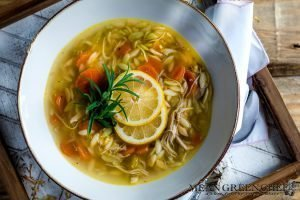 Lemon Chicken Orzo Soup on a wooden background