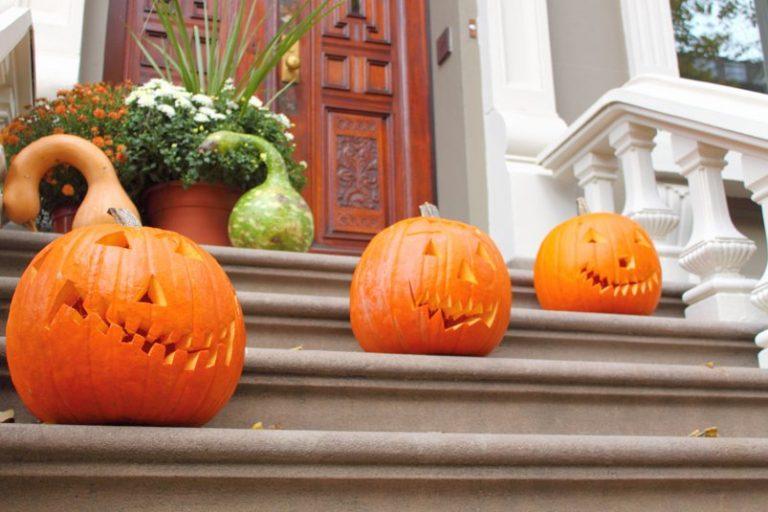 Carved pumpkins on a stoop