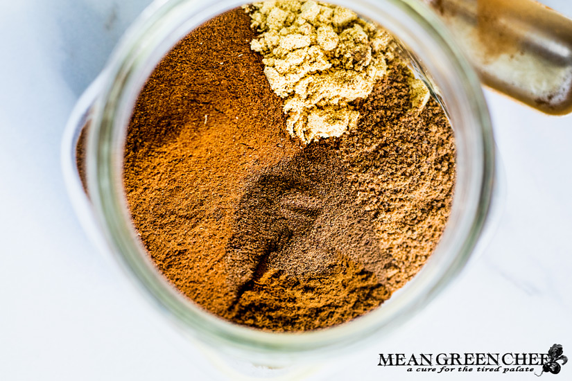 Ingredients for homemade pumpkin pie spice in a jar.