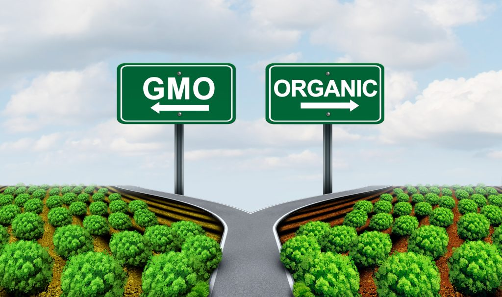 Signs pointing in different directions for GMO or Organic